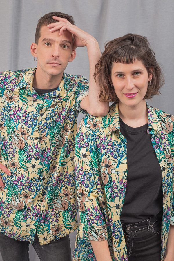 woman and man in cream and green floower pattern shirt