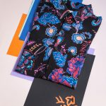 Art photo of printed black shirt with blue and orange details