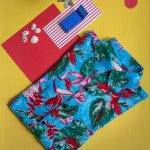 Creative photo of shirt on the beach, turquoise and red print