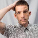 Young man with Keith Haring print short sleeve shirt