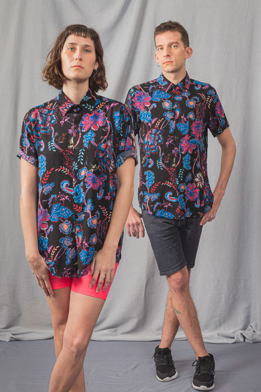 Photo of couple with black unisex shirt, stamped with blue and red flowers