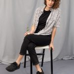 Woman with black and white patterned short sleeve shirt