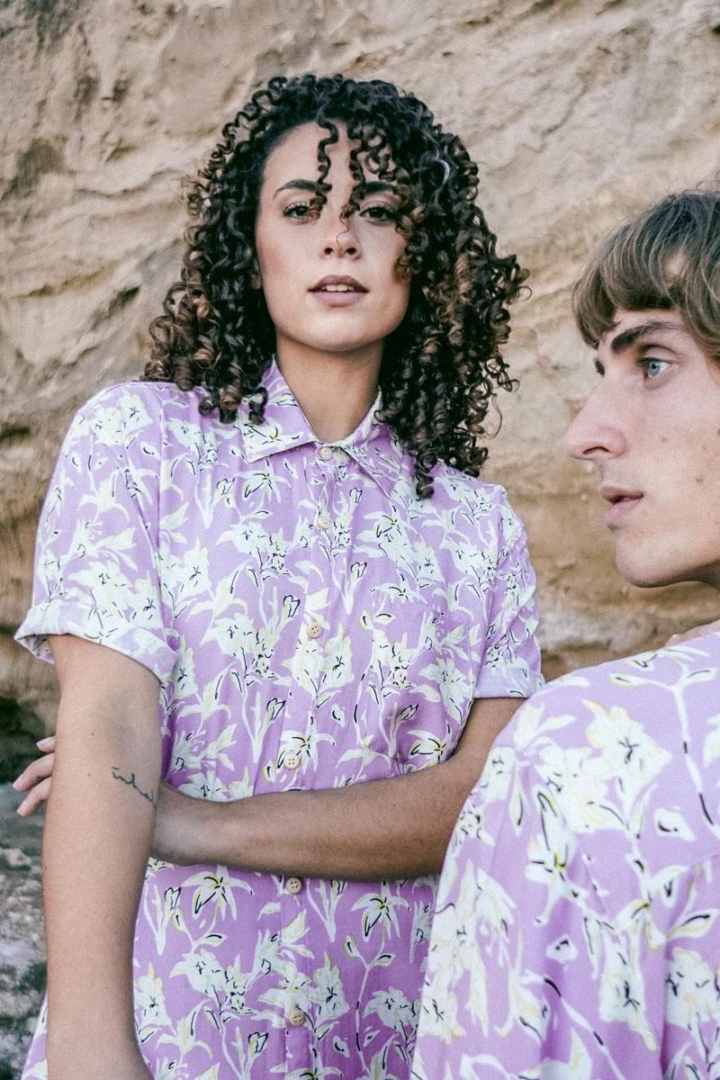 woman and man wearing a light purple shirt